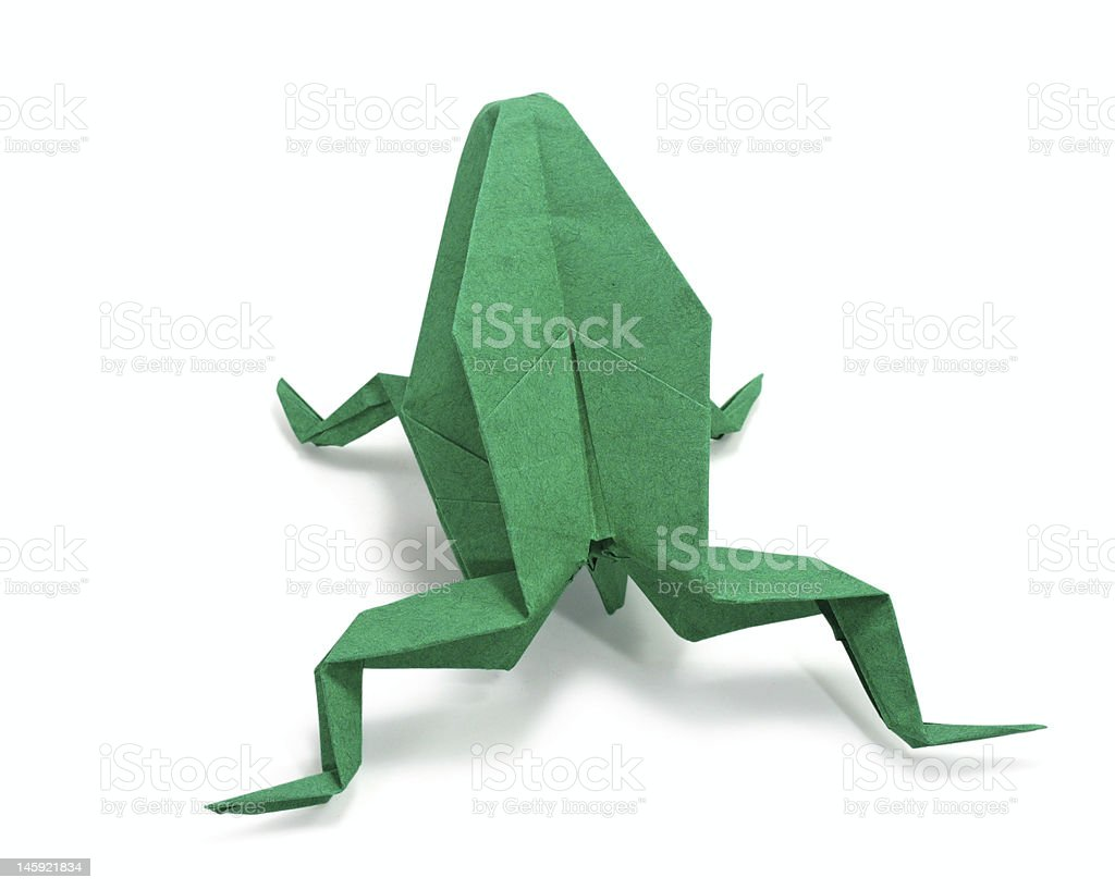 Green origami frog on white background stock photo