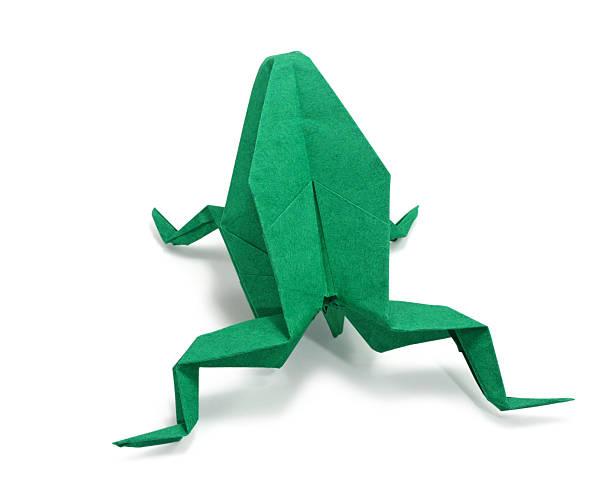 Green origami frog on white background stock photo