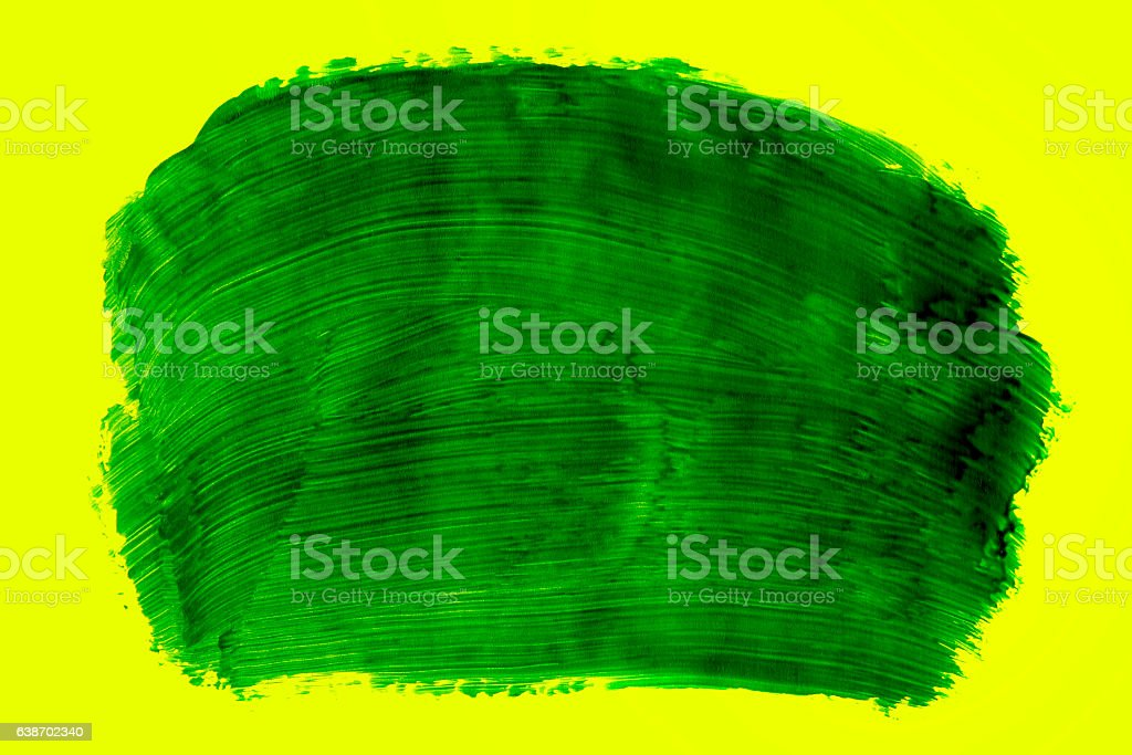 Green paint on a yellow background stock photo