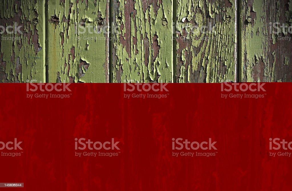 Green paint peeling from a wooden door panel stock photo