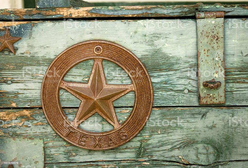 Green paint peeling on Wooden box with Texas star royalty-free stock photo
