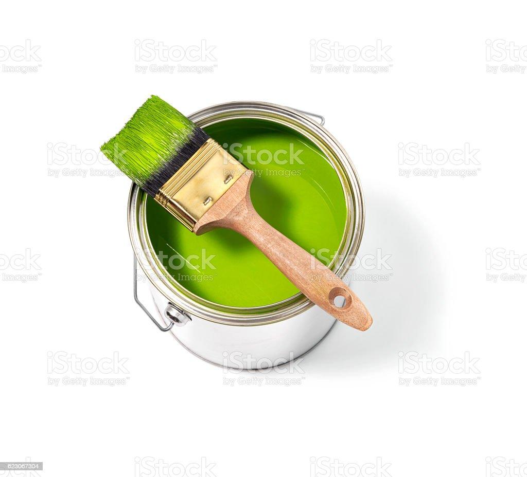 Green paint tin can with brush on top stok fotoğrafı