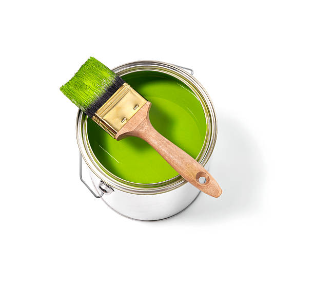 Green paint tin can with brush on top ストックフォト