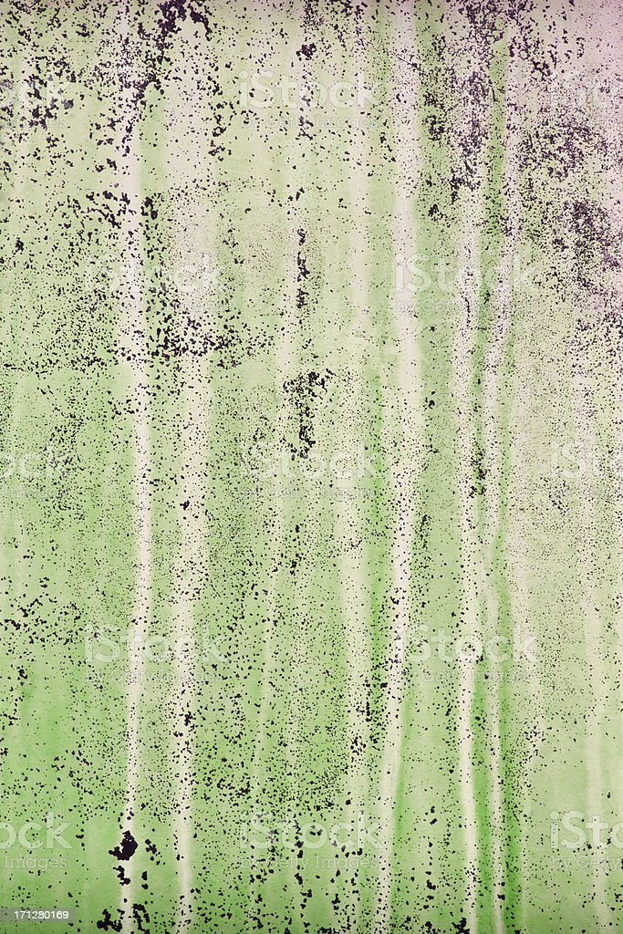 Green painted background with erosion stains and leaks royalty-free stock photo