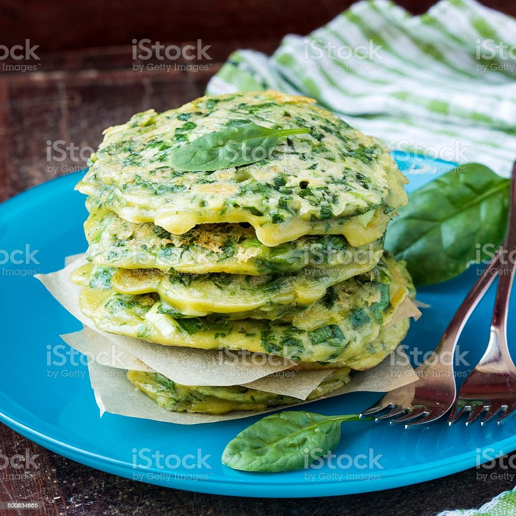 Green pancakes with herbs parsley, spinach, onions, delicious stock photo