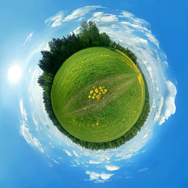 Green panorama globe This is a 360 degree view of a green field that I have morphed into a globe. fish eye lens stock pictures, royalty-free photos & images