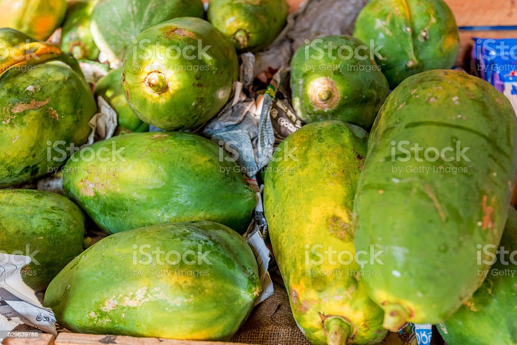 Green papaya in native market stock photo