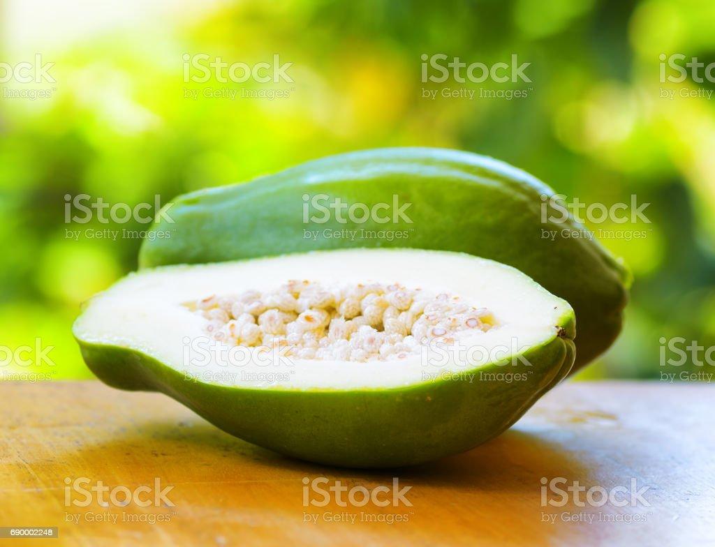 Green papaya on nature background stock photo