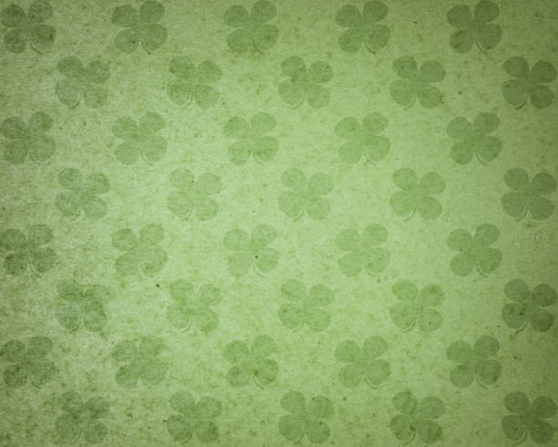 green paper with clover pattern - st patricks day background stock pictures, royalty-free photos & images