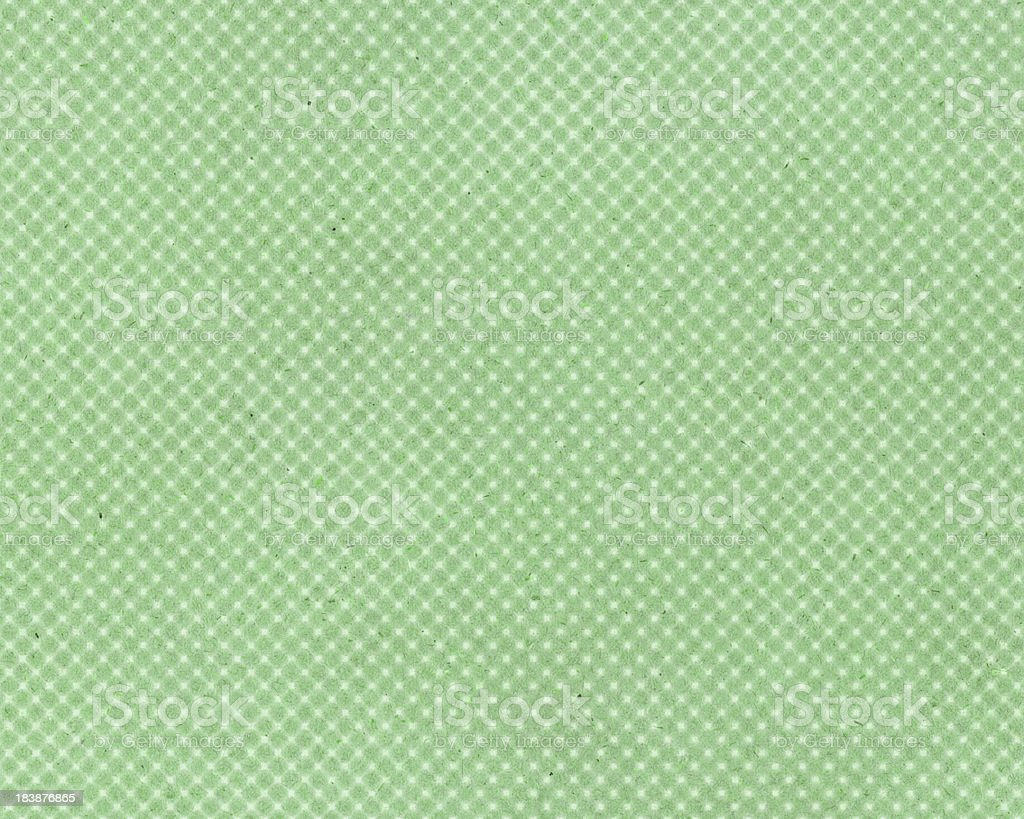 green paper with faded dot pattern royalty-free stock photo