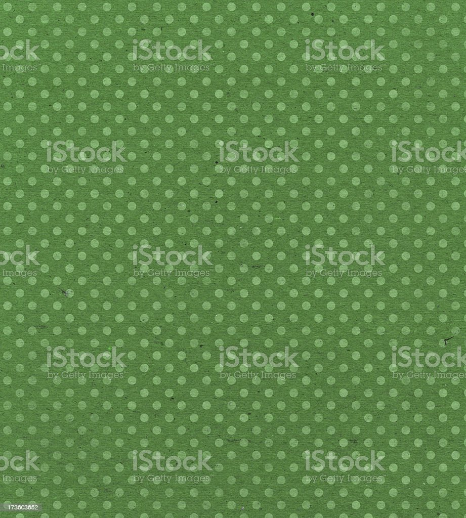 green paper with faded dots royalty-free stock photo