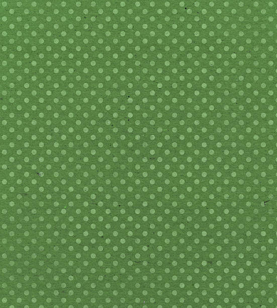 green paper with faded dots stock photo