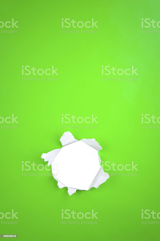 Green paper with torn hole royalty-free stock photo