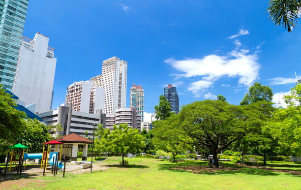 Green park in the center of Makati, Philippines stock photo