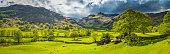 istock Green pasture idyllic mountain valley panorama Langdale Lake District Cumbria 476494998