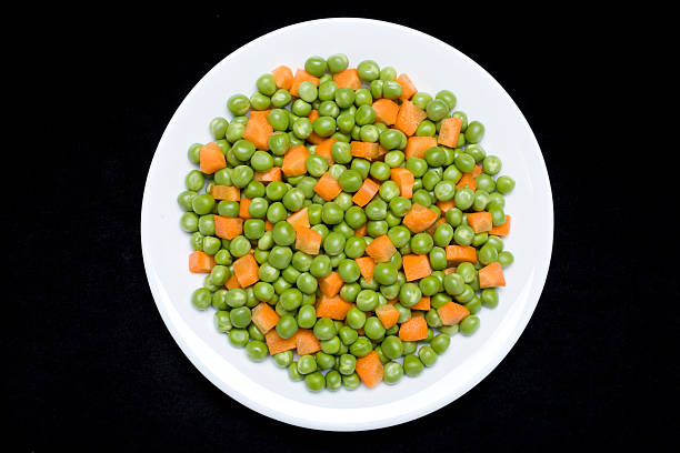Green pea and carrot stock photo