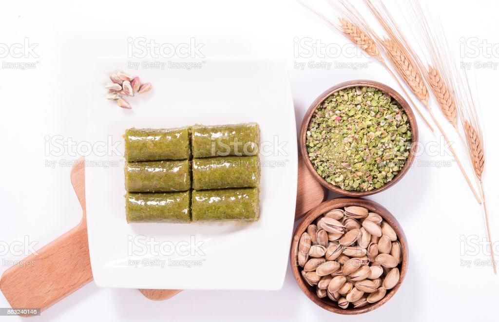green peanut wrapped baklava stock photo