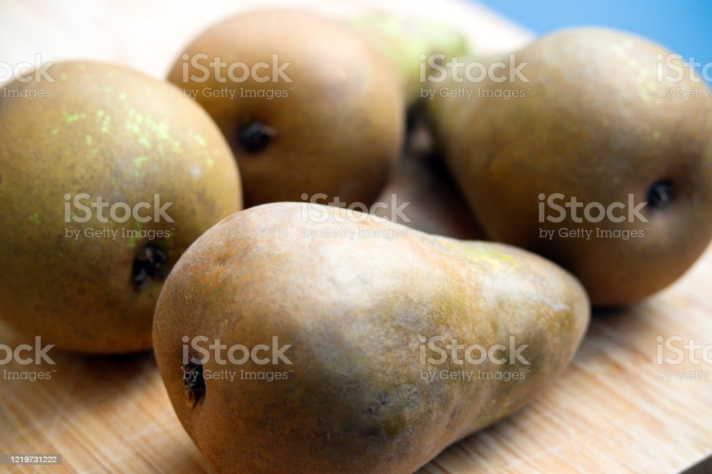 Green pears on a wooden board - Royalty-free Agriculture Stock Photo