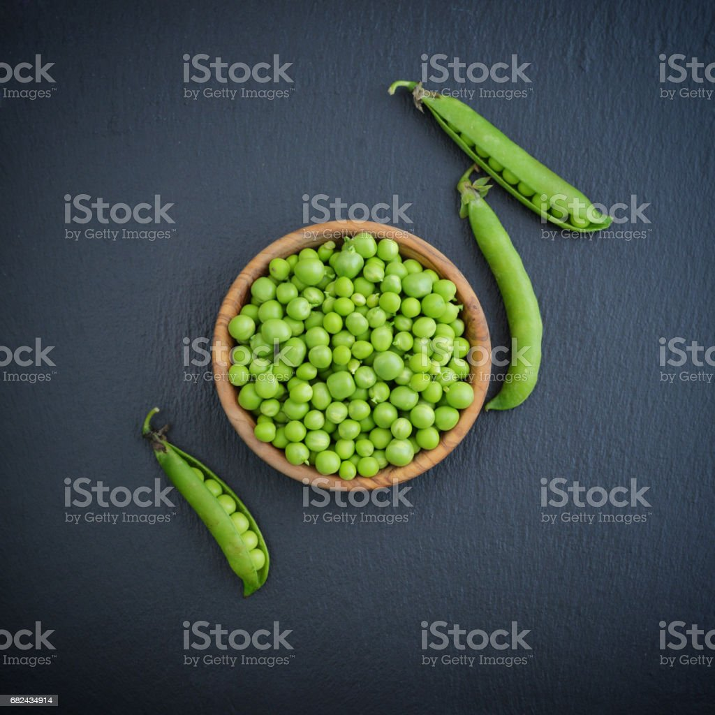 Green peas in wooden bowl royalty-free stock photo
