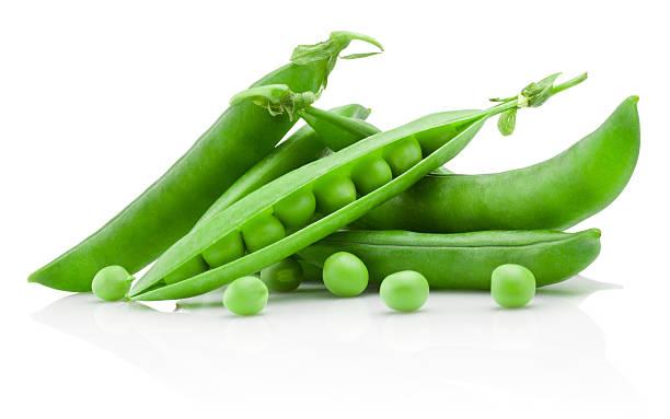 green peas isolated on white background - pea sprouts bildbanksfoton och bilder