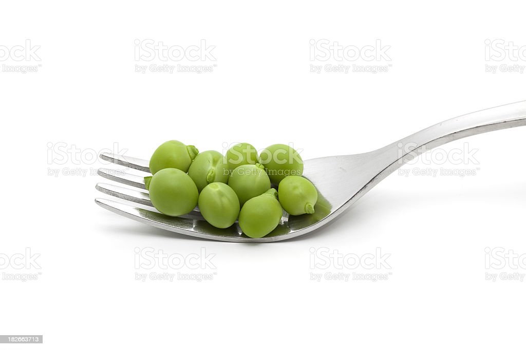 green peas on fork royalty-free stock photo
