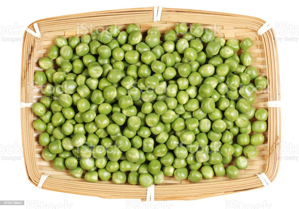 Green peas on the wooden board    on   white background royalty-free stock photo