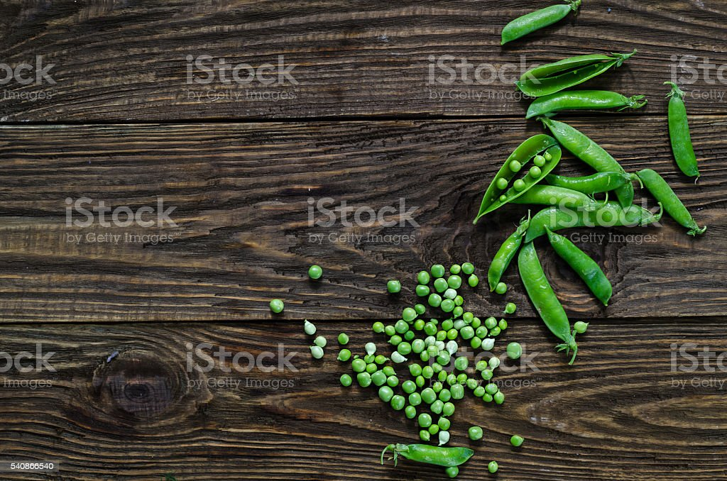 Green peas on the wooden floor. stock photo