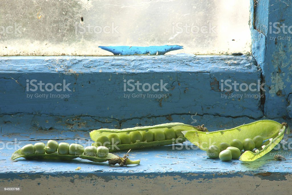 Green peas on window sill royalty-free stock photo