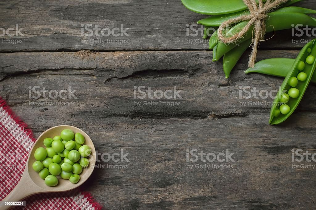 Green peas on wooden background royalty-free stock photo