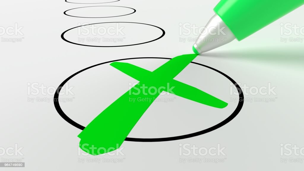 Green pen putting a cross in a circle on a checklist royalty-free stock photo