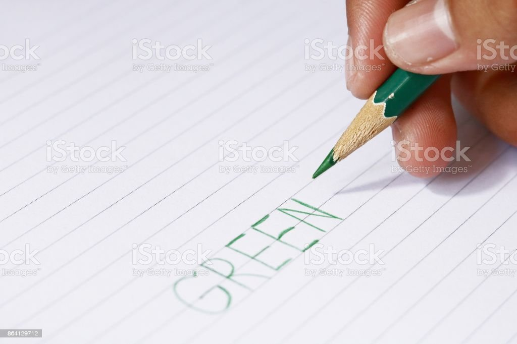 green pencil in blur man's hands royalty-free stock photo