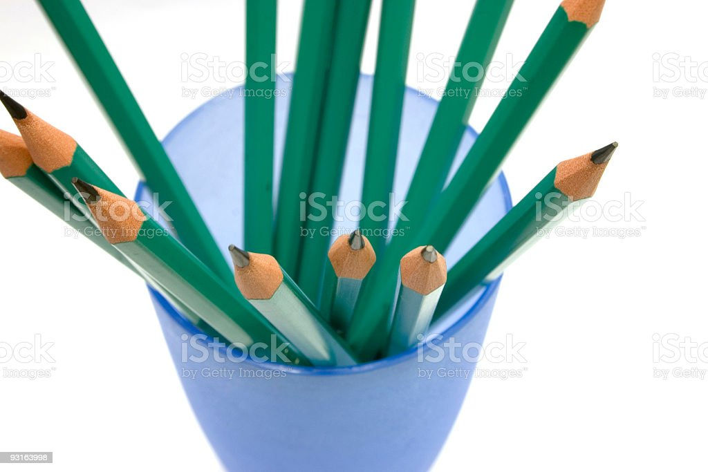 Green pencils in blue cup 2 royalty-free stock photo