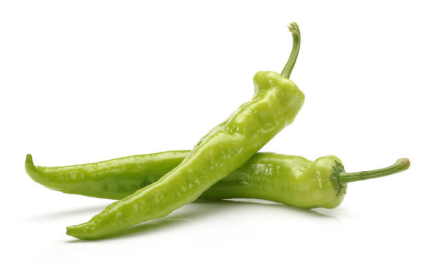 green pepper on a white background - green chilli pepper stock photos and pictures