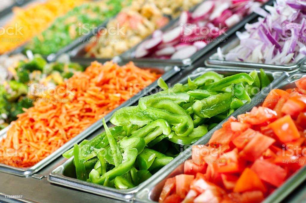 Green peppers and other fresh vegetables on a salad bar stock photo