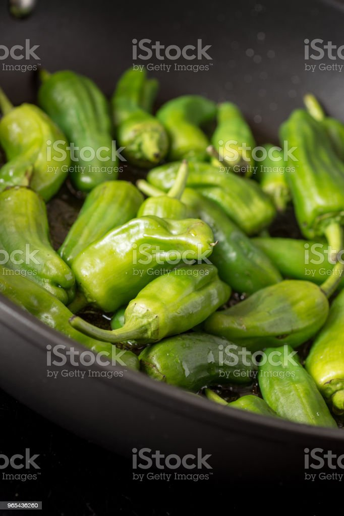 Green Peppers Padron Preparation in the Frying Pan royalty-free stock photo