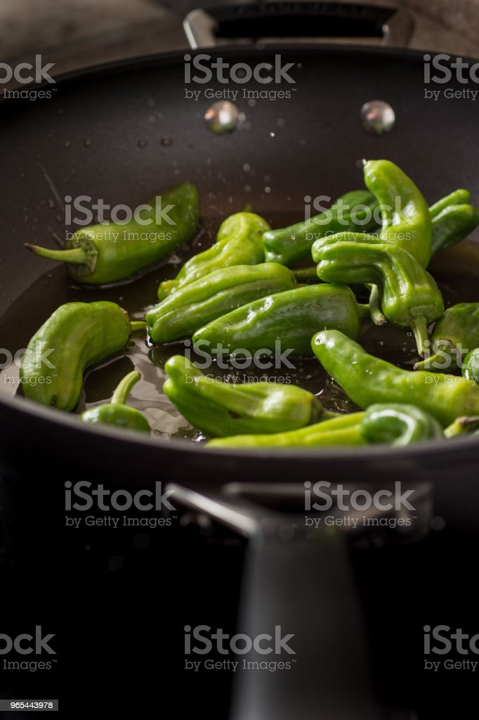 Green Peppers Padron Preparation in the Frying Pan zbiór zdjęć royalty-free