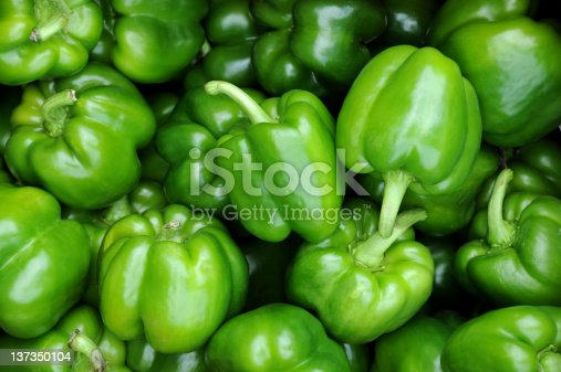 A close-up of a bunch of green peppers