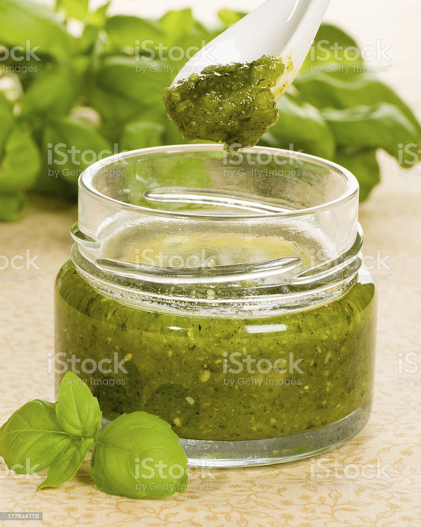 Green pesto in a jar royalty-free stock photo