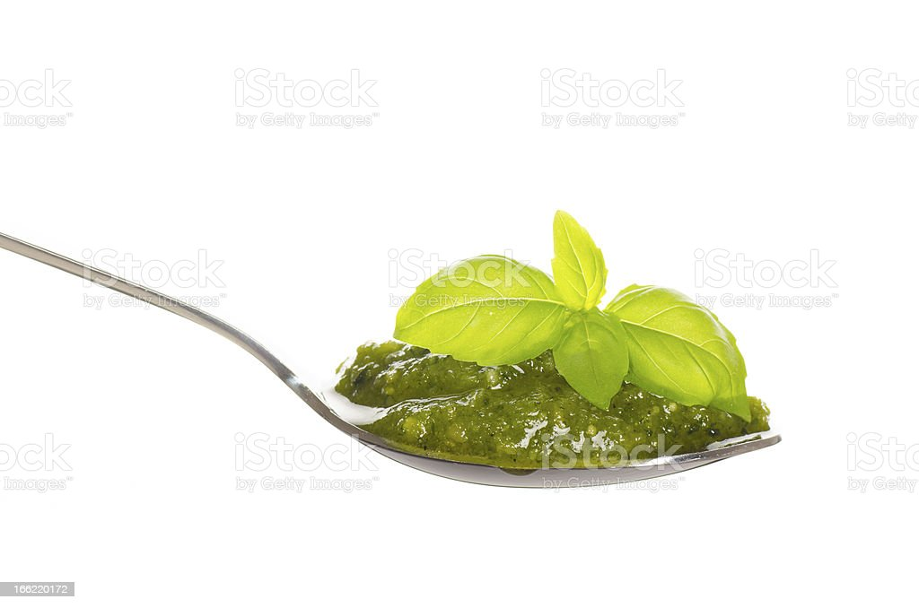 Green pesto in a spoon royalty-free stock photo
