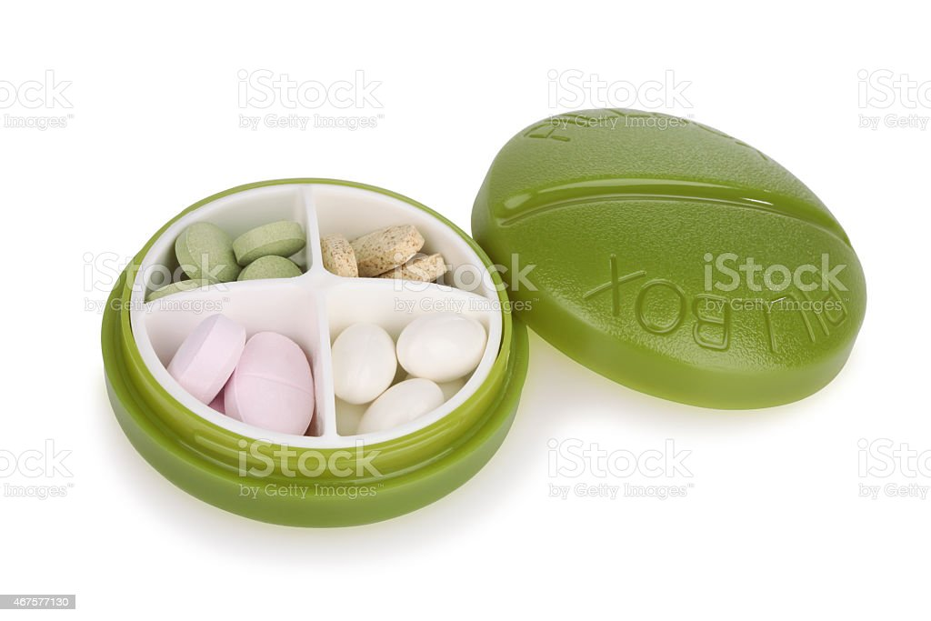 Green Pill Box and Pills stock photo