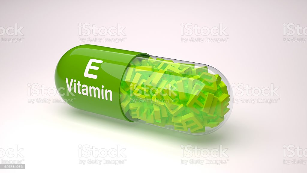 Green pill or capsule filled with vitamin E. stock photo