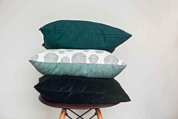 Green pillows on the chair Green pillows on the chair on light background cushion stock pictures, royalty-free photos & images