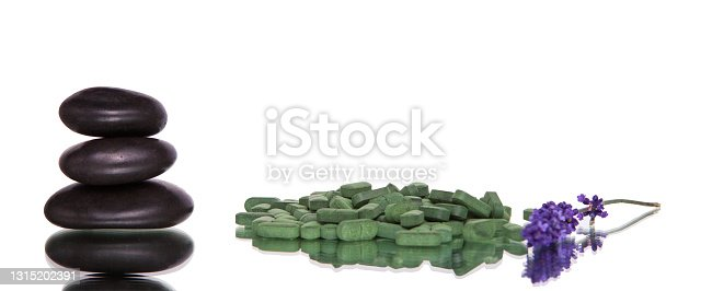 Green tablets , stone and lavender on white background, Isolated.