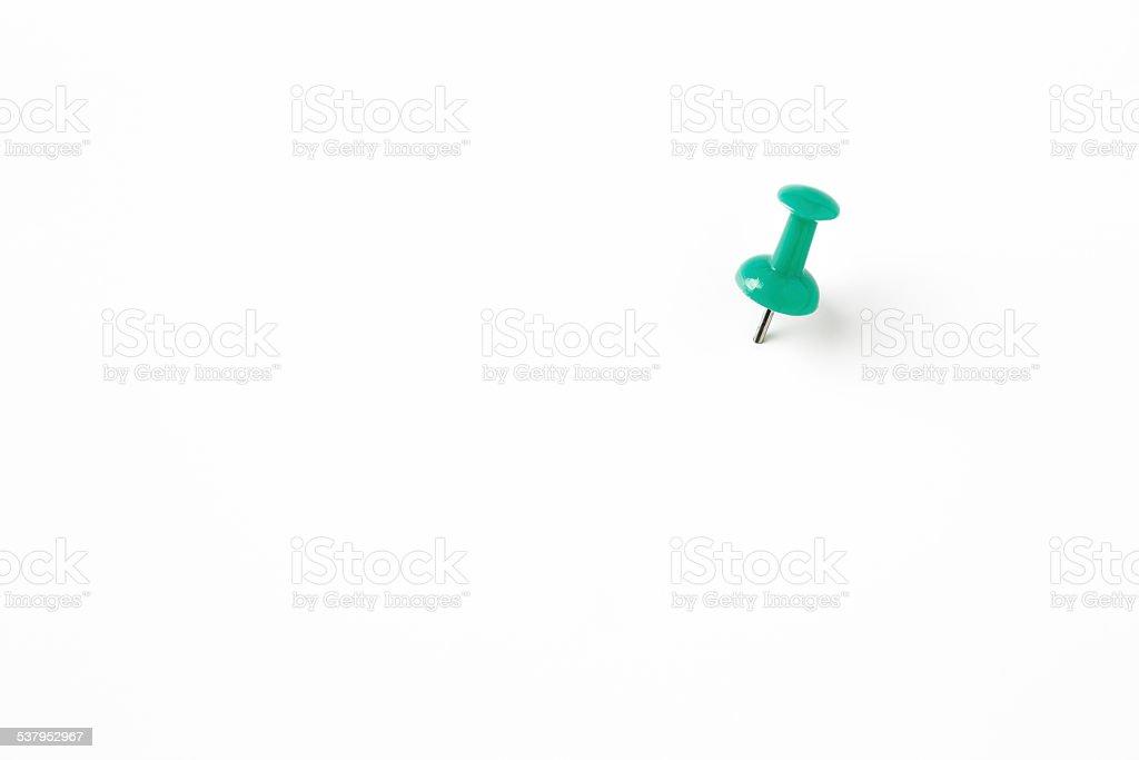 green pin on the white stock photo