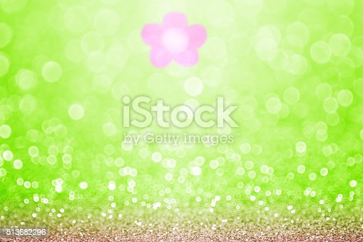 istock Green pink flower sparkle bokeh background 513682296