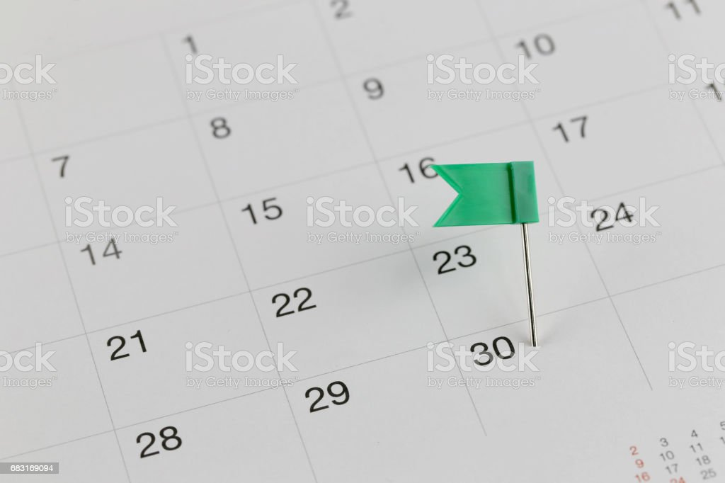 Green Pins to Wildcats on the calendar. 免版稅 stock photo