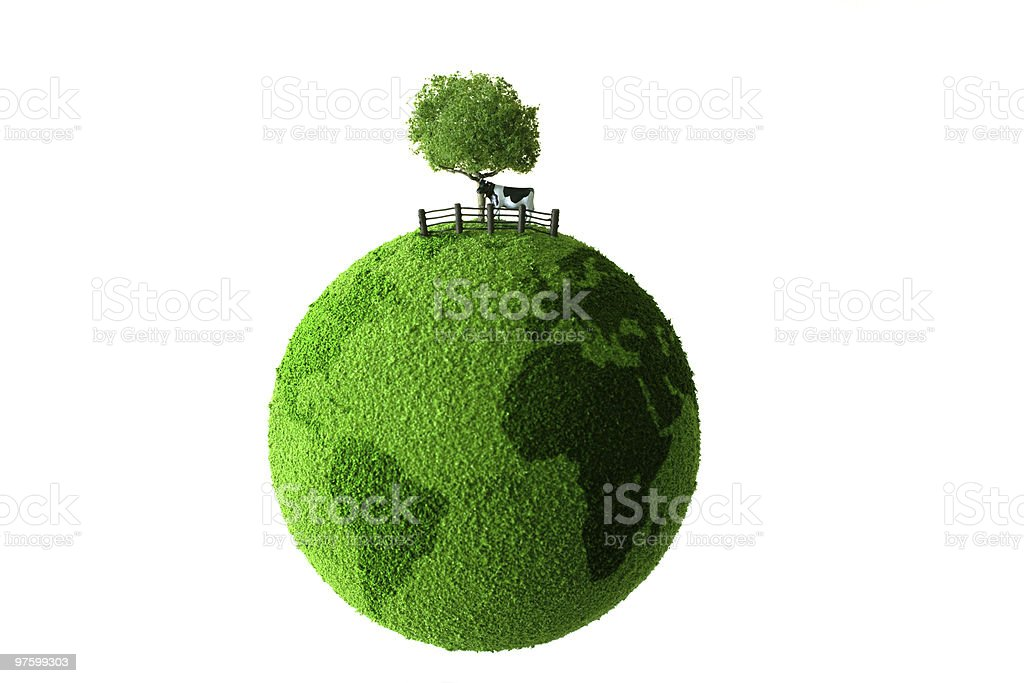 Green planet with tree and cow royalty-free stock photo