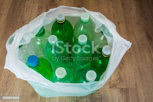istock Green plastic bottles with caps 839863656