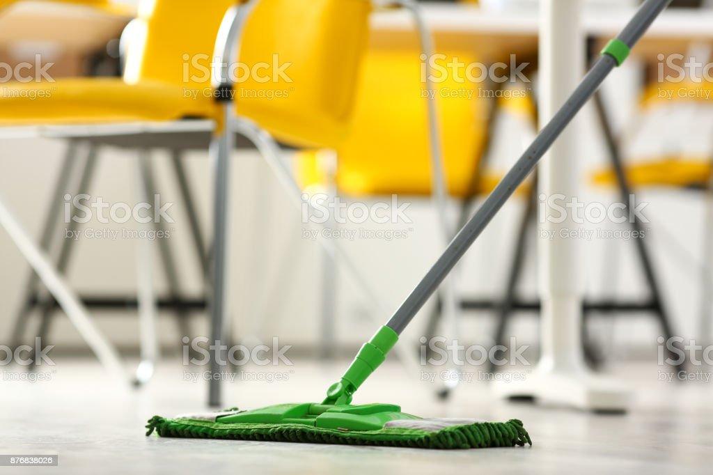 Green plastic mop stock photo