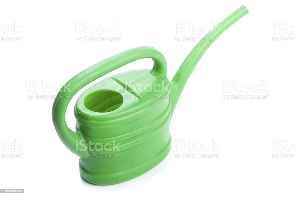 Green plastic toy watering can royalty-free stock photo